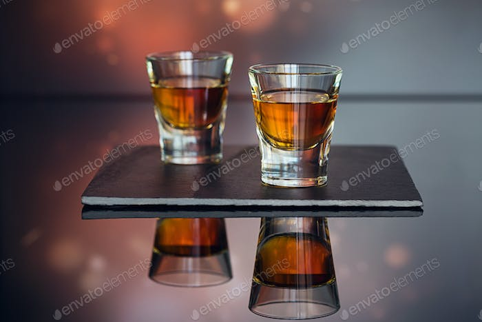 Cognac or Liqueur, Coffee Beans and Spices on a Glass Table