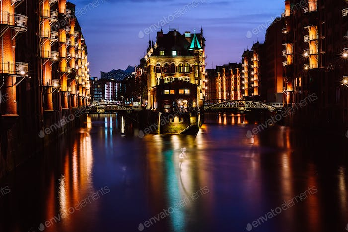 The Warehouse District - Speicherstadt in twilight. Tourism landmark of Hamburg. View of