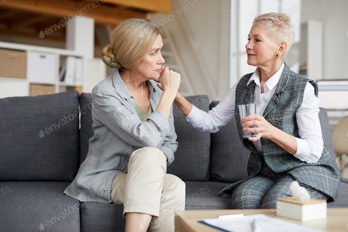 Female Therapist Comforting Senior Patient