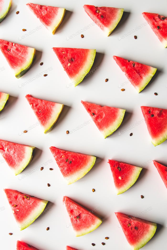 Seamless summer pattern. Watermelon slices, seeds on white background, top view