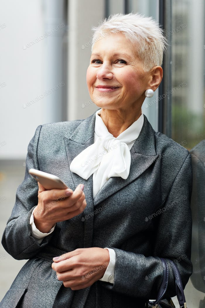 Mature businesswoman with mobile phone