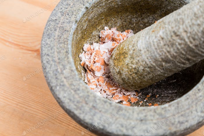 Kitchen mortar and pestle with crashed egg shell