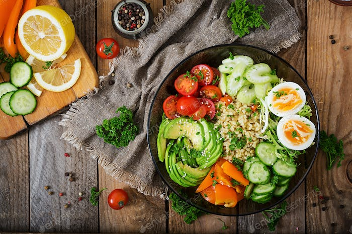 Bulgur porridge, egg and fresh vegetables - tomatoes, cucumber, celery and avocado