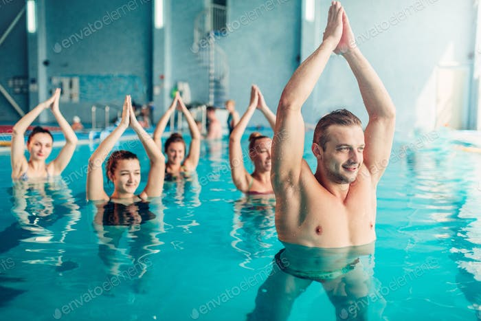 Women aqua aerobics class in water sport center