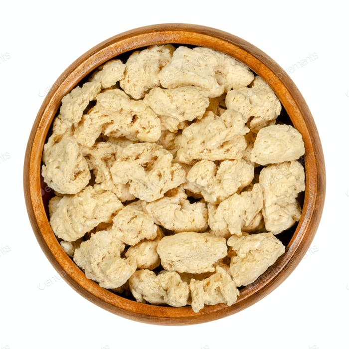 Soya chunks, textured soy protein, soy meat in wooden bowl