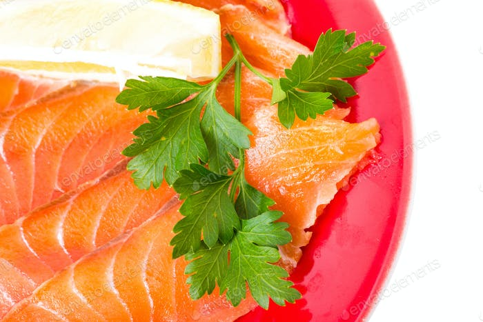 Sliced salmon with lemon and butter.
