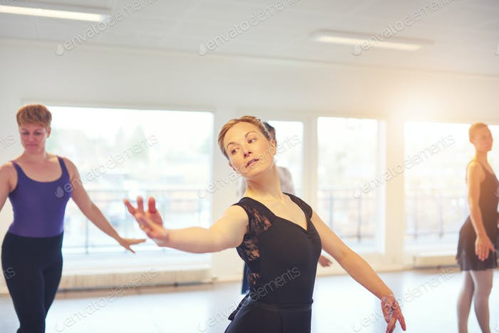Adult woman doing gymnastics in ballet class