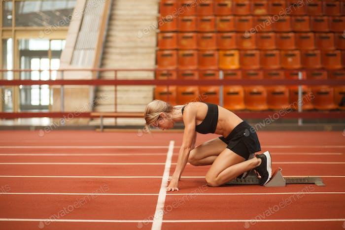 athletic white female training in stadium