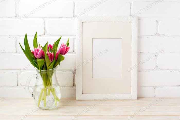 White frame mockup with pink tulips in glass vase