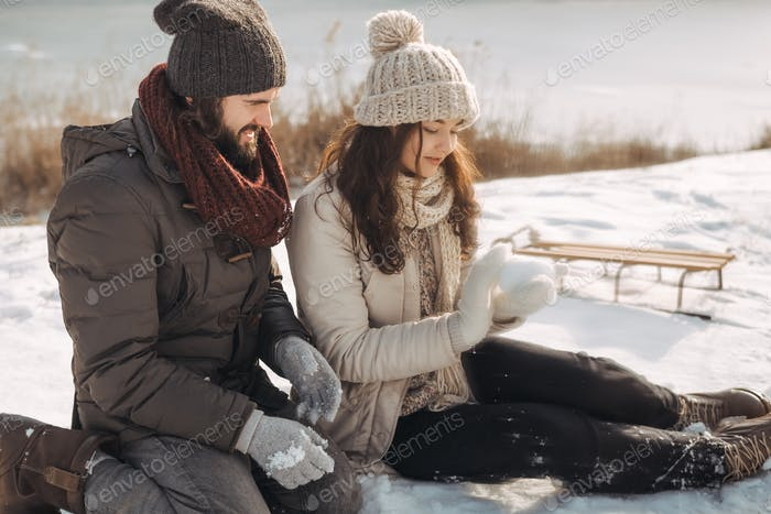 Couple Resting in Winter Holidays Outdoors