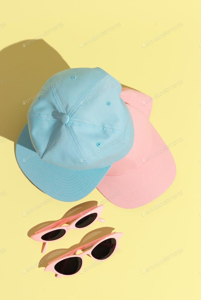 Stylish summer accessories cap and sunglasses.  Fashion still life concept