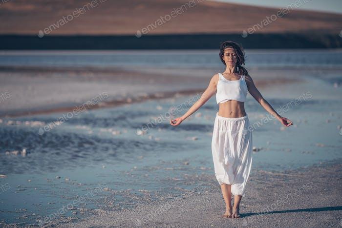 Asttractive woman doing yoga