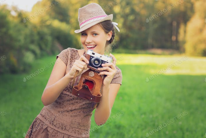 Thumbnail for beautiful teen age girl with retro camera