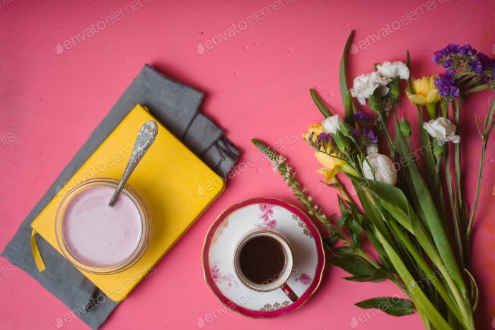 Spring breakfast on the pink background  top view