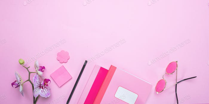 Women. Flowers and female accessories against pink background, copy space