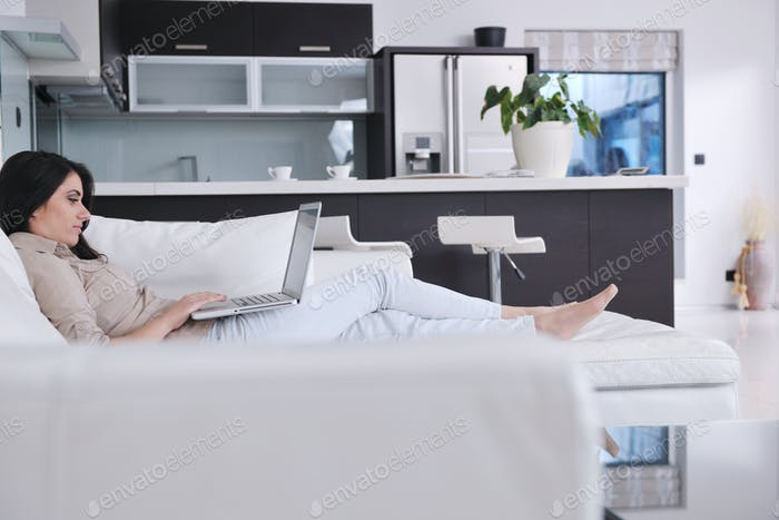 woman work on laptop at home