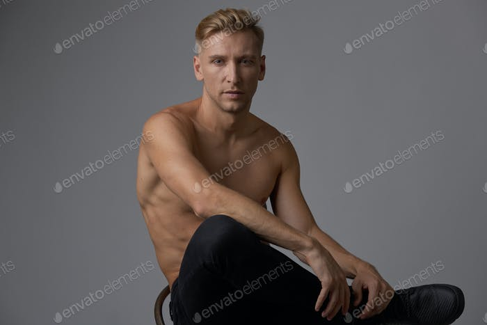 Handsome muscular young man posing at studio