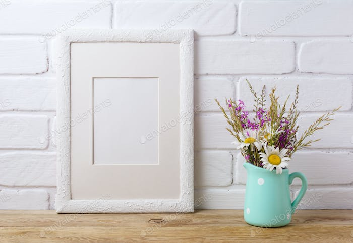 White frame mockup with chamomile and purple field flowers in mi