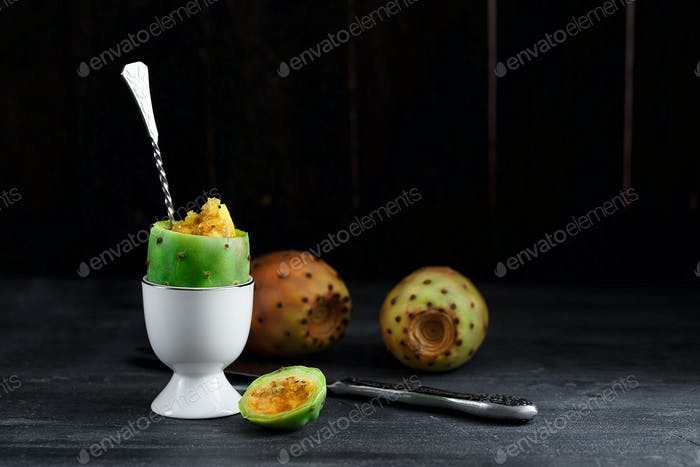Prickly pear fruit or cactus opentia in egg cup, close view, copyspace