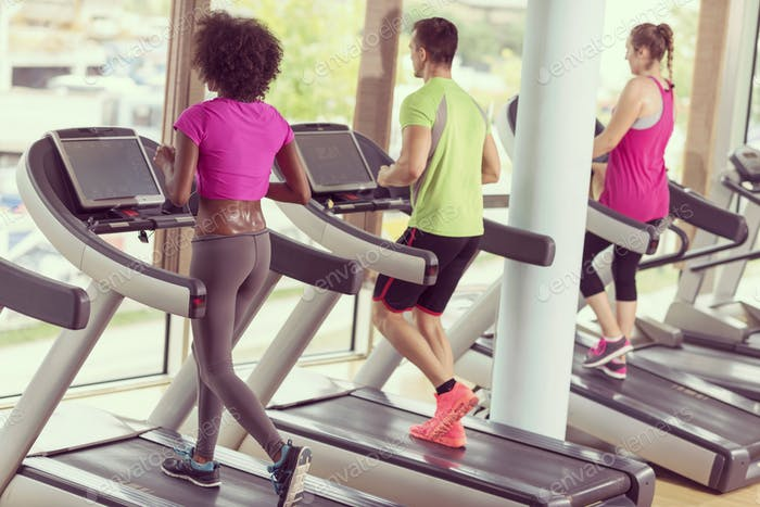 people exercisinng a cardio on treadmill