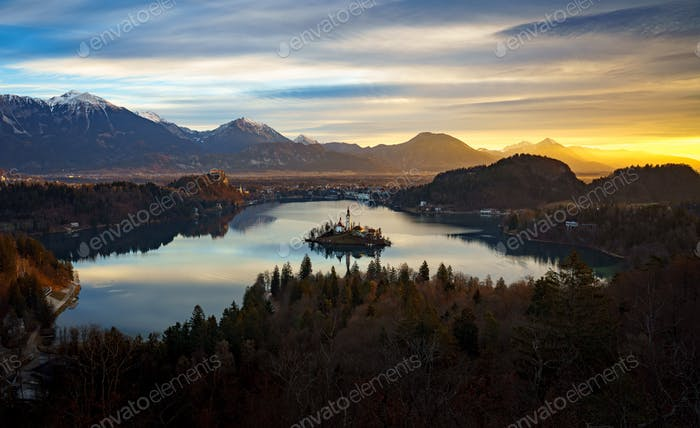 Aerial view of Lake Bled and Julian Alps with Church of the Assumption of Maria at sunrise, Slovenia