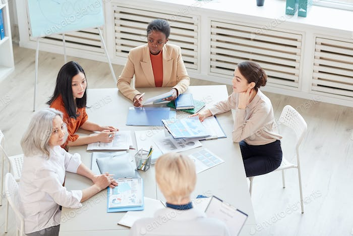 All-Female Business Team Meeting in Office