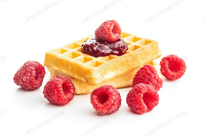 Tasty sweet waffles with raspberries and jam.