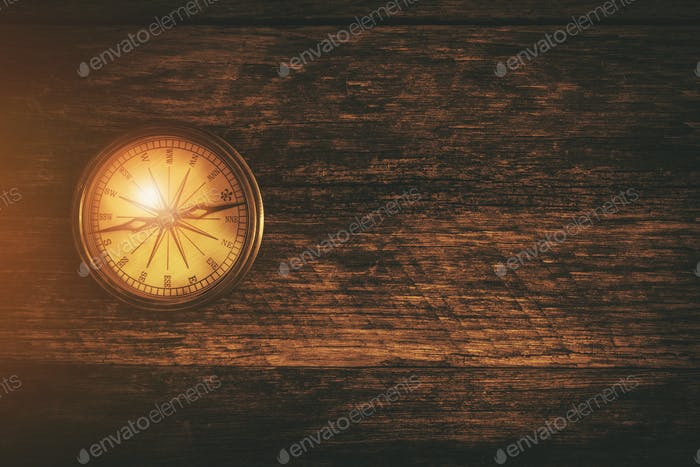 Compass and Wood Background