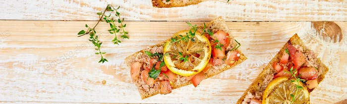 Banner of Appetizer bruschetta with tuna and tomatoes. Italian cuisine.