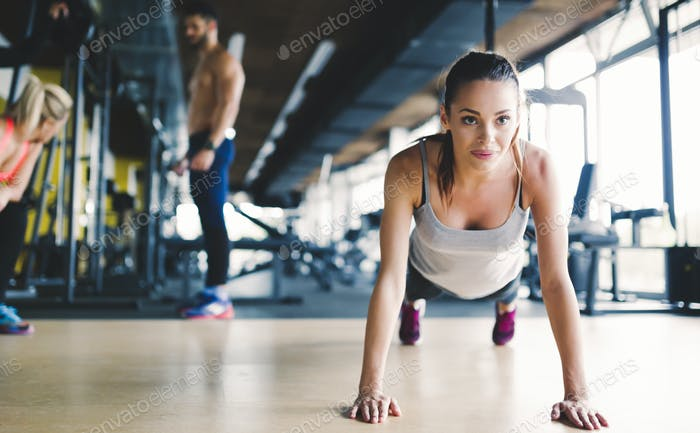 Healthy focused girl doing push ups