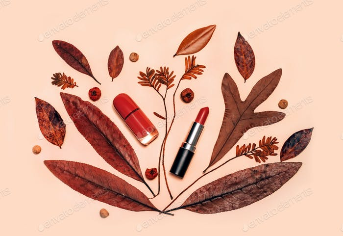 Decorative flat lay composition with cosmetics and Autumn leaves