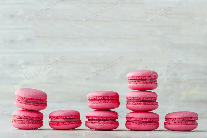 Pink macaroon on a white background