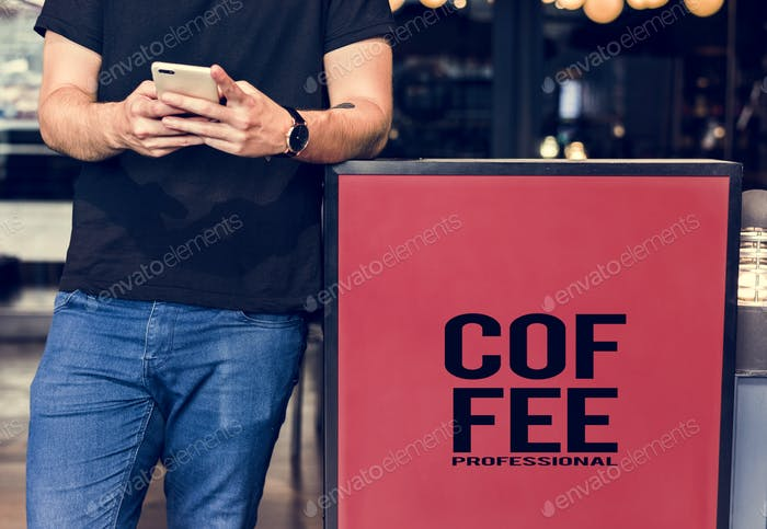 Young man waiting at a coffee shop