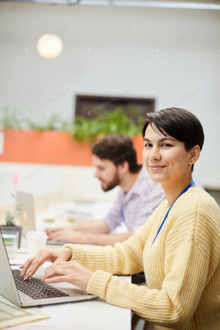 Woman by laptop
