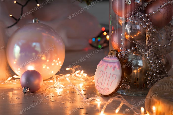Christmas decorations and cookies on wooden background