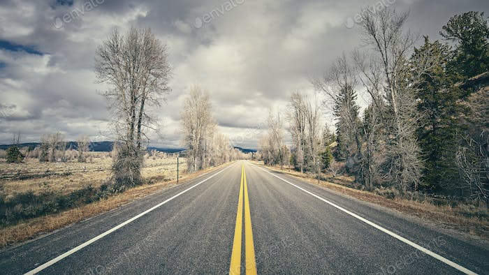 Retro stylized scenic road, travel concept, Grand Teton National