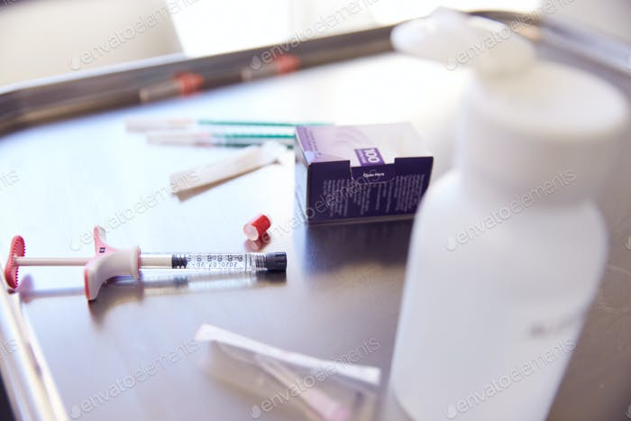 Close Up Of Syringe And Treatment Used For Botox Injection