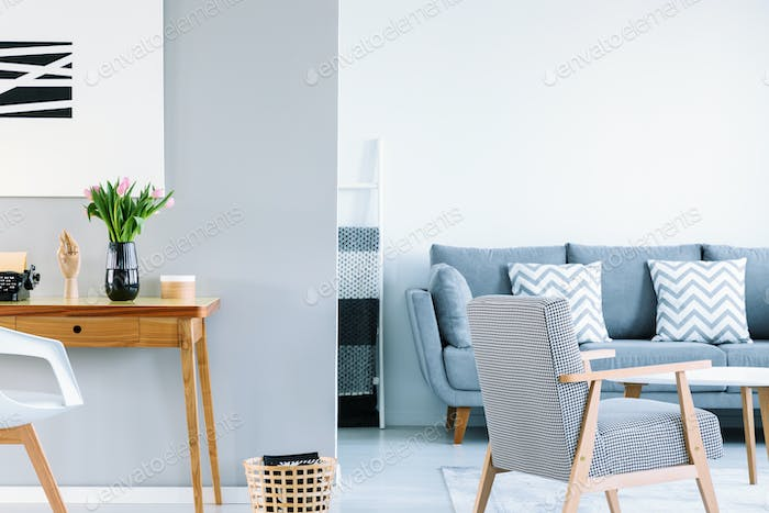 White and grey open space living room interior with patterned ar