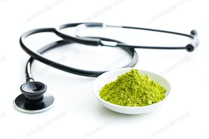 Green matcha tea powder.