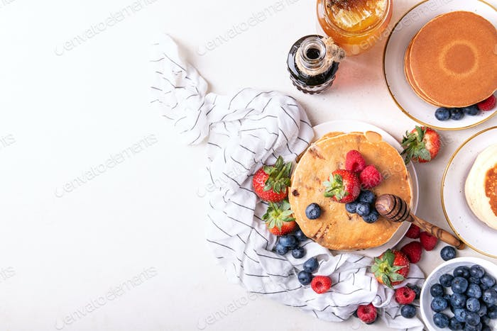 Blueberry pancakes served with honey