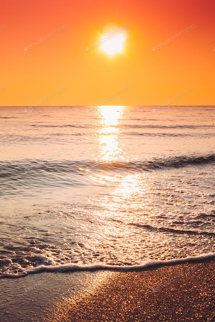 Sun Is Setting On Horizon At Sunset Sunrise Over Sea Or Ocean. T