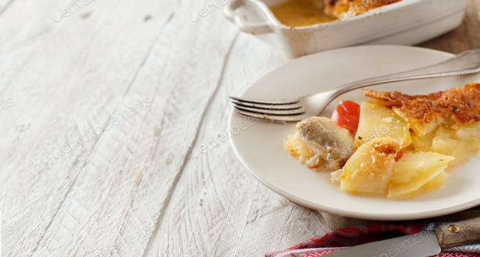 Codfish or baccala with potatoes cooked in the oven