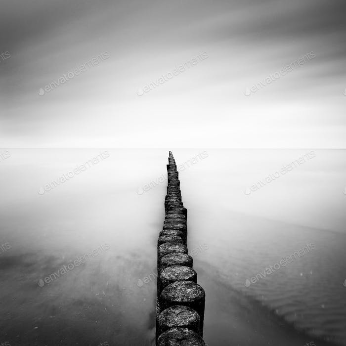 The Baltic Sea coast with pier during rainy day, Usedom, Germany.