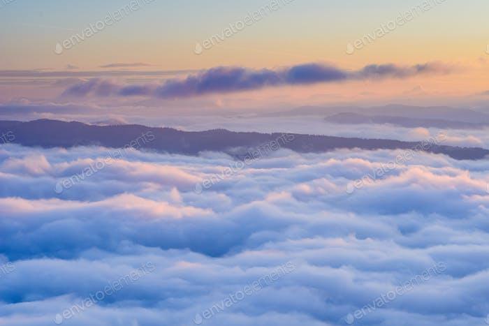 Cumulus fantastic fog in the morning sky