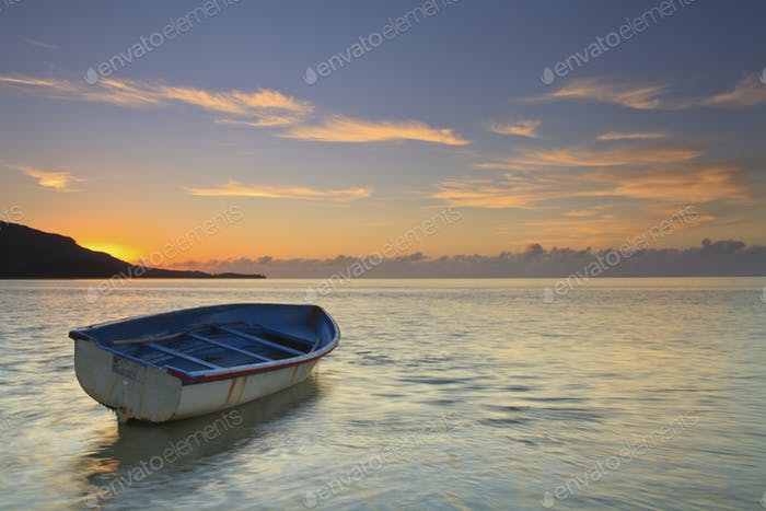Sunrise on tropical island with boat