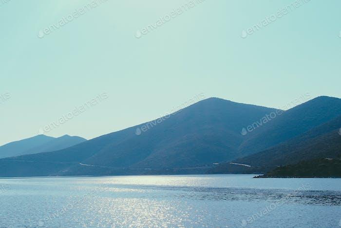 Pyramidal mountain chain across the seashore of Aegean Sea in Greece.