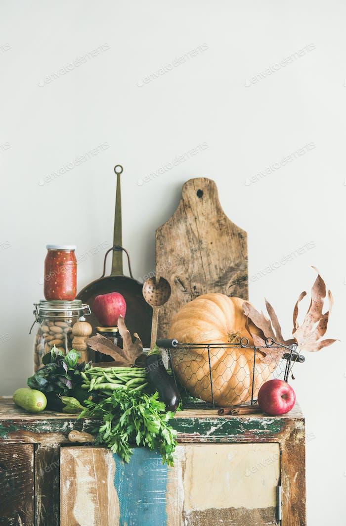 Autumn seasonal food ingredients and kitchen utensils