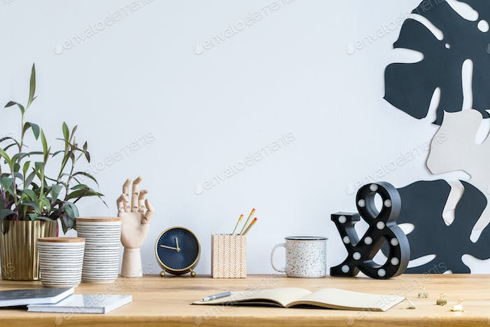 Desk, plant and clock