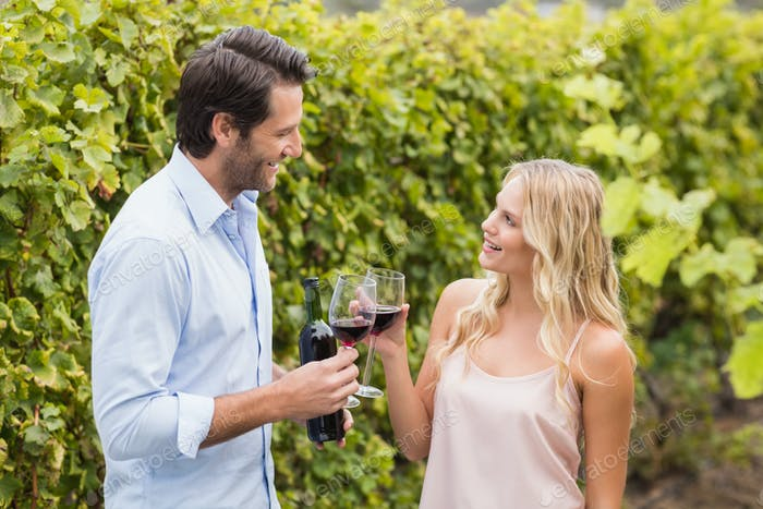 Young happy couple talking in the grape fields