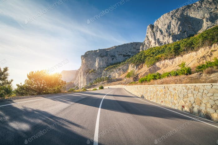 Asphalt road in summer at sunrise